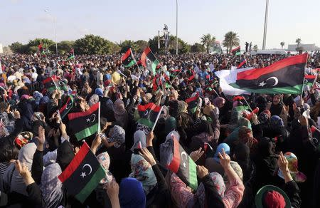 People attend a rally in support of former Libyan army officer Khalifa Haftar, in Benghazi