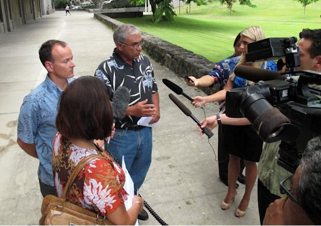 Chairman William Aila of the Hawaii Department of Land and Natural Resources, center, speaks to reporters at a news conference in Honolulu on Tuesday, Aug. 20, 2013. Hawaii officials plan to spend the