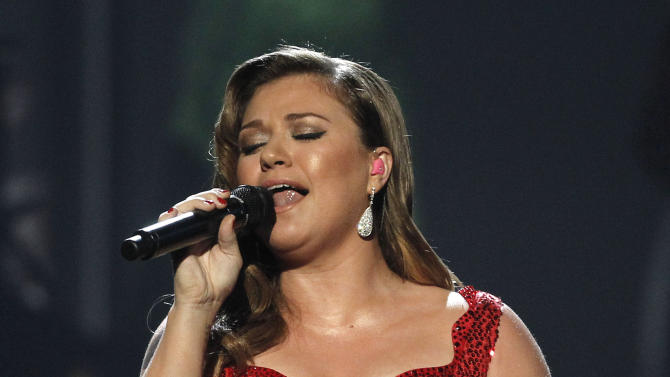 FILE - In this Nov. 20, 2011 file photo, Kelly Clarkson performs at the 39th Annual American Music Awards in Los Angeles.  A person familiar with Super Bowl entertainment plans says Clarkson will sing the national anthem before the NFL championship game at Indianapolis on Feb. 5.  The person spoke to The Associated Press on Wednesday, Jan. 11, 2012, on condition of anonymity because no announcement has been made. (AP Photo/Matt Sayles, File)