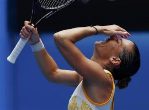 Flavia Pennetta of Italy celebrates defeating Angelique Kerber of Germany during their women's singles match at the Australian Open 2014 tennis tournament in Melbourne