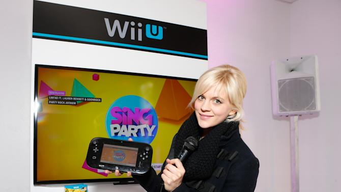 Actress Georgia King warms up and checks out Wii U at the Nintendo Lounge while playing SiNG Party during a break from the Sundance Film Festival on Saturday, January 20, 2013 in Park City, UT. (Photo by Todd Williamson/Invision for Nintendo/AP Images)