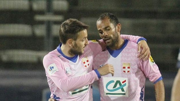 Saber Khlifa (2ndL) of Evian Thonon-Gaillard celebrates with team mates after scoring against Paris St-Germain during their French Cup quarter-final match (Reuters)