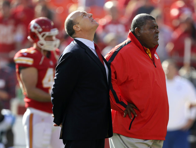 Kansas City Chiefs general manager Scott Pioli, left, and coach Romeo Crennel stand together before an NFL football game against the Carolina Panthers at Arrowhead Stadium in Kansas City, Mo., Sunday,