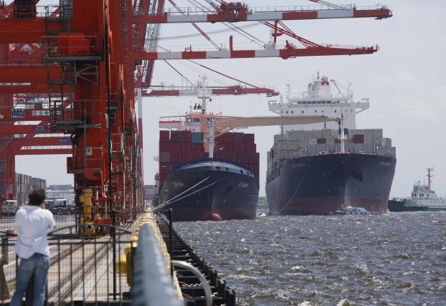 FILE - In this Aug. 13, 2012 file photo, container ship, right, arrives at a container terminal in Tokyo. Major Japanese manufacturers are increasingly gloomy over an outlook darkened by weakening growth both at home and overseas, a quarterly survey by Japan's central bank showed Monday, Oct. 1. (AP Photo/Koji Sasahara, File)