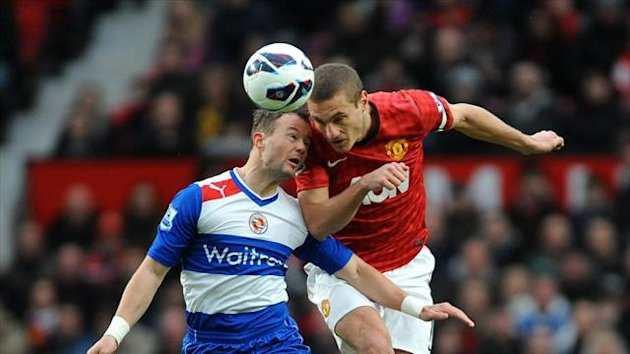 Nemanja Vidic, right, urged caution over Manchester United's 15-point Premier League lead