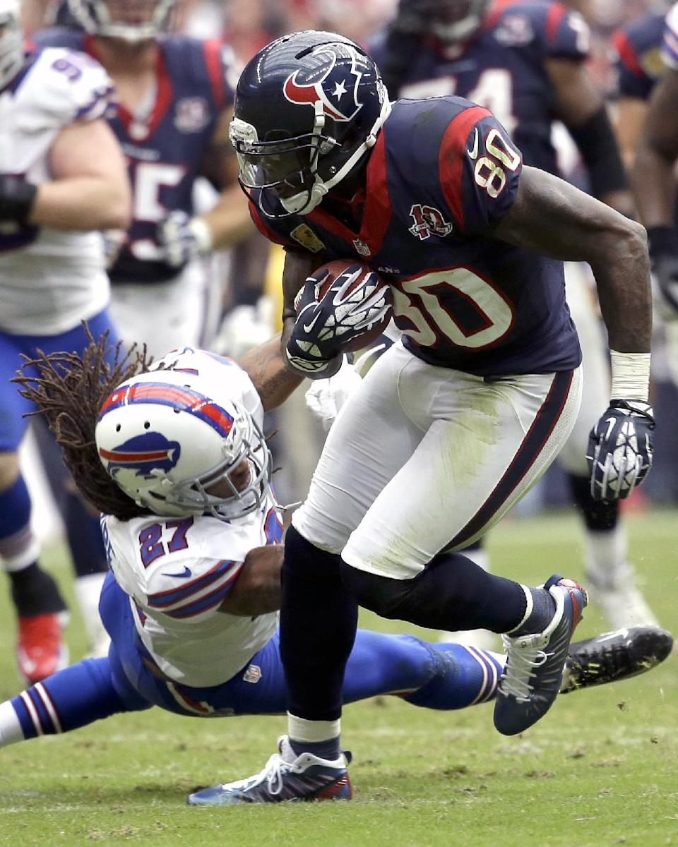 Houston Texans wide receiver Andre Johnson (80) breaks away from Buffalo Bills cornerback Stephon Gilmore (27) for a first down in the fourth quarter of an NFL football game on Sunday, Nov. 4, 2012, in Houston. (AP Photo/David J. Phillip)