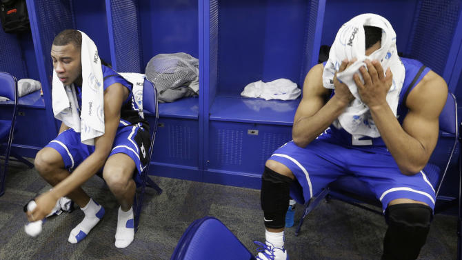 Duke guards Rasheed Sulaimon, left, and Quinn Cook sit in the locker room after Louisville defeated Duke 85-63 in the Midwest Regional final in the NCAA college basketball tournament, Sunday, March 31, 2013, in Indianapolis. (AP Photo/Darron Cummings)