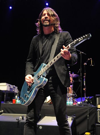 Musician Dave Grohl performs on stage at the Sound City Players concert at The Manhattan Center Hammerstein Ballroom, Wednesday, Feb. 13, 2013, in New York. (Photo by Brad Barket/Invision/AP)