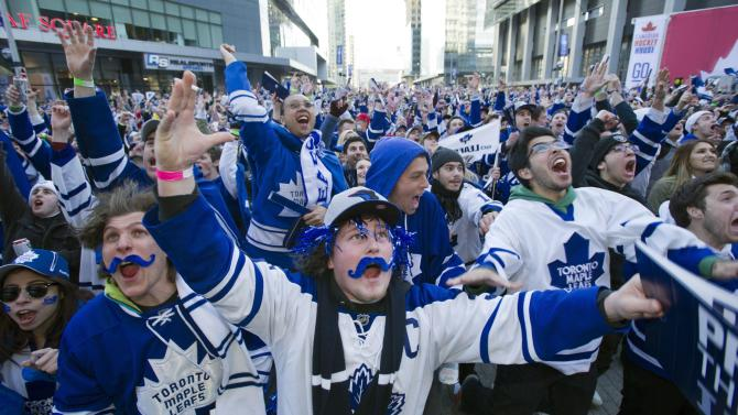Toronto Maple Leafs fans celebrate the Leafs first goal while watching the game at Maple Leafs Square in Toronto on Monday May 13, 2013.  (AP Photo/The Canadian Press, Frank Gunn)