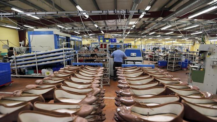Employees work on ballerinas 'Cendrillon' at the production workshop in the Repetto factory in Saint-Medard d'Excideuil, southwestern France