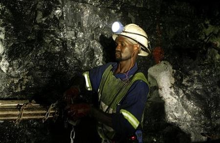 Mine workers is seend underground in Modderfontein east mine, outside Johannesburg, February 3, 2009. REUTERS/Siphiwe Sibeko