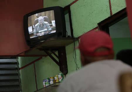 Cuba's President Castro speaks during a television broadcast in Havana