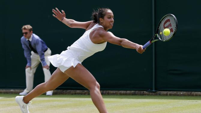 Madison Keys of the U.S.A. hits a shot during her match against Olga Govortsova of Belarus at the Wimbledon Tennis Championships in London