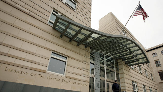 The US flag flies at f the main entrance of the US embassy in Berlin, Germany, Friday, Oct. 25, 2013. European Union leaders on Friday vowed to maintain a strong trans-Atlantic partnership despite their anger over allegations of widespread U.S. spying on its allies. France and Germany insist new surveillance rules should be agreed with the United States by the end of the year.. On Thursday's opening day of the summit, the spying issue united the 28 EU leaders in criticizing the snooping after allegations surfaced that German Chancellor Angela Merkel had one of her mobile phones tapped by U.S. services. (AP Photo/Michael Sohn)