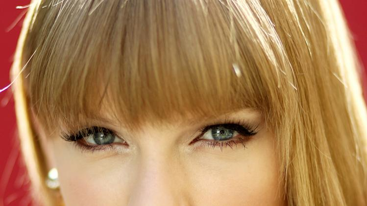 "In this Oct. 17, 2012 photo, musician Taylor Swift poses for a portrait in Los Angeles, Calif. Swift's new album, ""Red,"" will be released Oct. 22. (Photo by Matt Sayles/Invision/AP)"