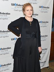 Adele is back in head-to-toe black at music industry luncheon