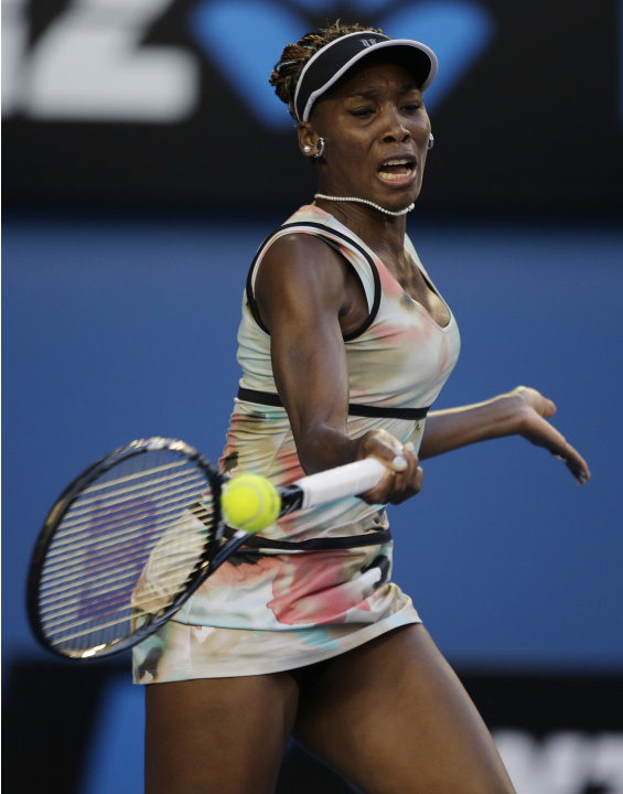 Venus Williams of the US hits a forehand to France&amp;#39;s Alize Cornet during their second round match at the Australian Open tennis championship in Melbourne, Australia, Wednesday, Jan. 16, 2013. (AP 