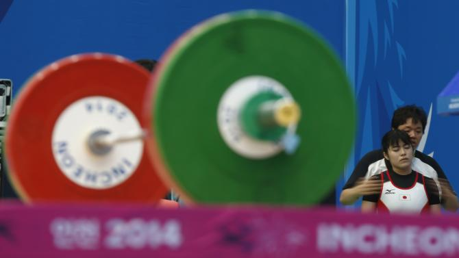 Matsumoto prepares to compete in the women's 63kg snatch weightlifting competition during the 17th Asian Games in Incheon