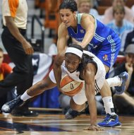 Connecticut Sun's Danielle McCray, bottom, is pressured by New York Liberty's Nicole Powell during the first half of a WNBA basketball game in Uncasville, Conn., Friday, June 15, 2012. (AP Photo/Jessica Hill)