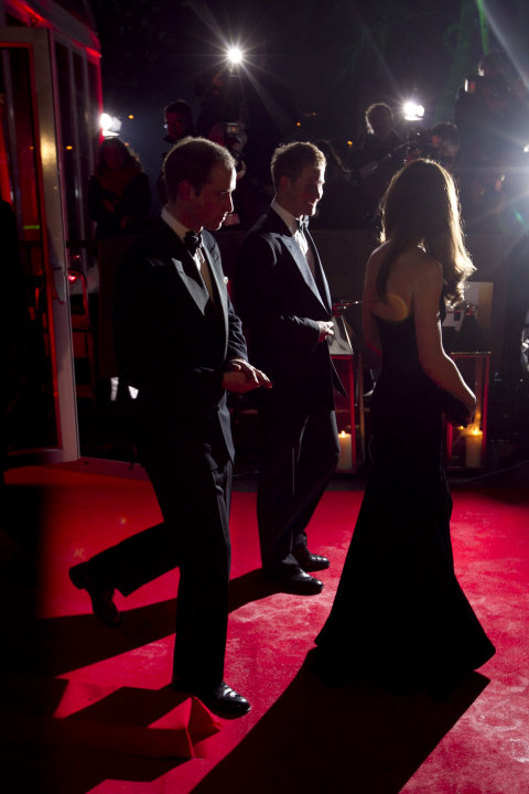 "Britain's Prince William, left, his wife Kate, Duchess of Cambridge, right, and his brother Prince Harry attend ""A Night of Heroes: The Sun Military Awards"" at the Imperial War Museum in London, Monda"