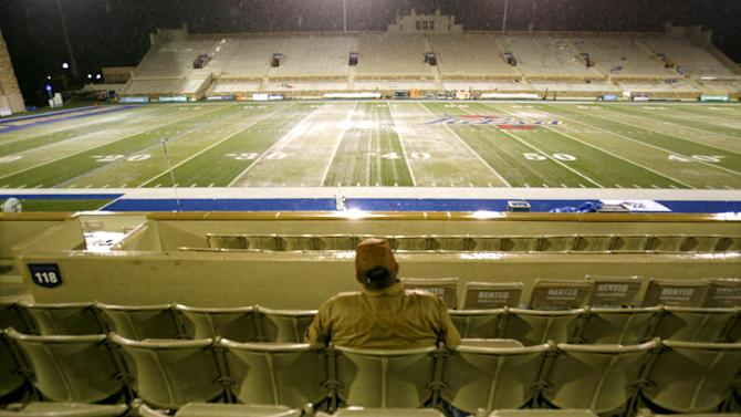 Tulsa alumnus G.E. Beard sits alone in the rain in the stands of H.A. Chapman Stadium as heavy rain and lightning delayed the start of an NCAA college football game between Tulsa and Oklahoma State in Tulsa, Okla., Saturday, Sept. 17, 2011. (AP Photo/Dave Crenshaw)