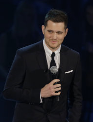 "FILE - In this Nov. 26, 2012 file photo, Canadian singer Michael Buble' performs during the Italian State RAI TV program ""Che Tempo che Fa"", in Milan, Italy. Most of Buble's albums have reached multiplatinum status and his last three releases have hit No. 1 on the Billboard 200 albums chart, including 2011's triple platinum ""Christmas."" His new album, ""To Be Loved,"" will be released April 23 and includes a tribute to his wife, Argentine TV actress Luisana Lopilato. (AP Photo/Luca Bruno, File)"