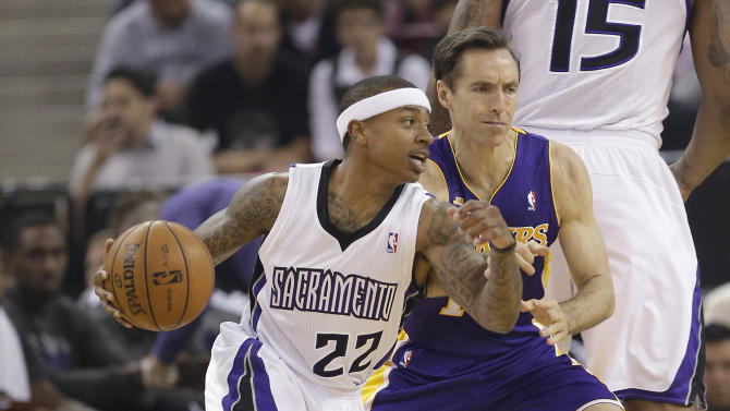 Los Angeles Lakers guard Steve Nash, right, tries to stop the drive of Sacramento Kings guard Isaiah Thomas during the first quarter of an NBA basketball game in Sacramento, Calif., Saturday, March 30, 2013. (AP Photo/Rich Pedroncelli)