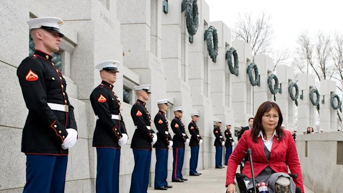 FILE - In this Thursday, March 11, 2010 file photo, Tammy Duckworth, assistant secretary for the U.S. Department of Veterans Affairs, arrives at the World War II Memorial in Washington for a ceremony honoring World War II veterans who fought in the Pacific. Duckworth, who is running in 2012 as a congressional candidate in Illinois, became a double amputee when her National Guard helicopter was shot down in Iraq in 2004. During the long wars in Afghanistan and Iraq, hundreds of thousands of veterans have come home and laid aside their uniforms. But not all have opted to simply blend back into civilian life. Many have chosen to run for public office. (AP Photo/Cliff Owen)