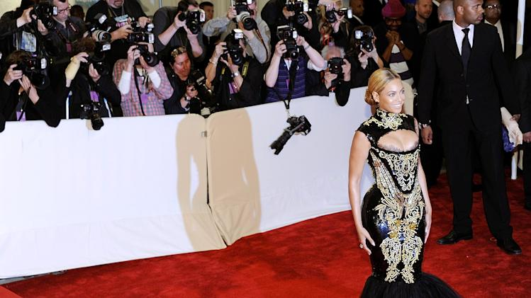 Singer Beyonce Knowles arrives at the Metropolitan Museum of Art Costume Institute gala, Monday, May 2, 2011 in New York.  (AP Photo/Evan Agostini)