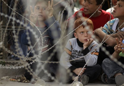 Palestinian boys attend a rally, calling for the release of Palestinian prisoners from Israeli jails, in Jabalya