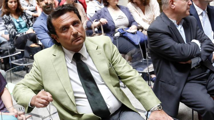 Captain of the capsized Costa Concordia Francesco Schettino looks at photographers as he attends a meeting in Rome
