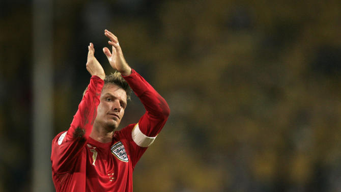 FILE - In this June 20, 2006, file photo, England's captain David Beckham acknowledges fans after their 2-2 draw with Sweden in a World Cup Group B soccer match at the World Cup Stadium in Cologne, Germany. The 38-year-old midfielder, who recently won a league title in a fourth country with Paris Saint-Germain, said Thursday, May 16, 2013, he will retire after the season.   (AP Photo/Kevork Djansezian, File)