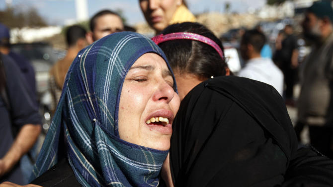 Relatives grieve Rushdi Tamimi who died of injuries sustained during clashes Saturday with Israeli security, during his funeral in the West Bank city of Ramallah, Tuesday, Nov 20, 2012. Tamimi was wounded during a protest against Israel's operation in Gaza on Saturday, Nov. 17, 2012. Efforts to end a week-old convulsion of Israeli-Palestinian violence drew in the world's top diplomats on Tuesday, with President Barack Obama dispatching his secretary of state to the region on an emergency mission and the U.N. chief appealing from Cairo for an immediate cease-fire. (AP Photo/Majdi Mohammed)