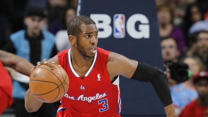 Los Angeles Clippers guard Chris Paul picks up a loose ball against the Denver Nuggets in the first quarter of an NBA basketball game in Denver, Thursday, March 7, 2013. (AP Photo/David Zalubowski)