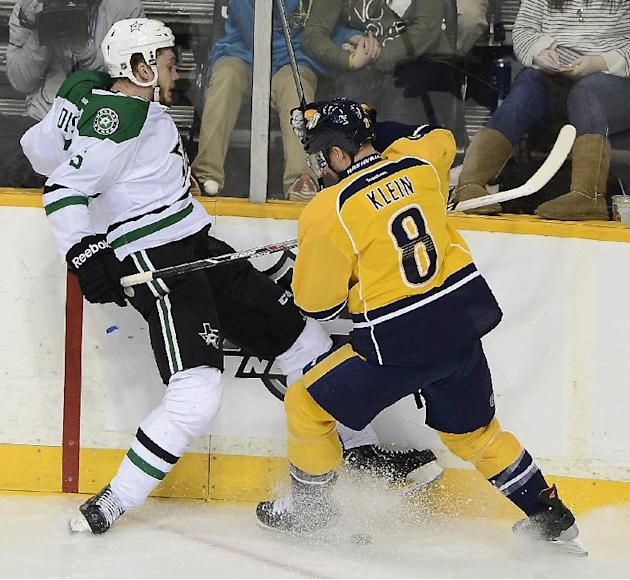 Nashville Predators defenseman Kevin Klein (8) and Dallas Stars defenseman Jamie Oleksiak (5) collide along the boards while trying to get control of the puck in the third period of an NHL hockey game