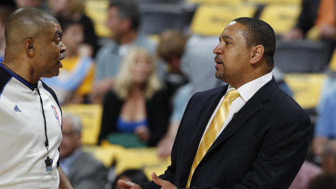 Golden State Warriors head coach Mark Jackson, right, argues a call against his team with referee Tony Brothers during the first quarter of Game 5 of their first-round NBA basketball playoff series against the Denver Nuggets, Tuesday, April 30, 2013, in Denver. (AP Photo/David Zalubowski)
