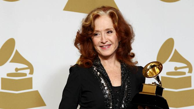 """Bonnie Raitt poses backstage with the award for best americana album for """"Slipstream"""" at the 55th annual Grammy Awards on Sunday, Feb. 10, 2013, in Los Angeles. (Photo by Matt Sayles/Invision/AP)"""