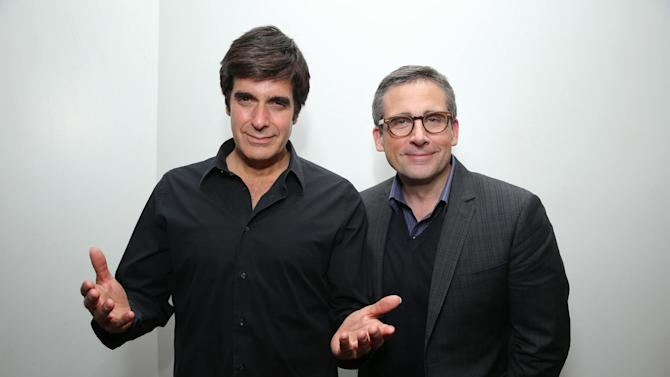 """IMAGE DISTRIBUTED FOR WARNER BROS. - David Copperfield, left, is seen with Steve Carell, star of the upcoming comedy """"The Incredible Burt Wonderstone,"""" who made a surprise appearance at David Copperfield's Las Vegas show on Friday, March 1, 2013.  The two met while working on the film, which is set in the world of magic, and opens nationwide on March 15th.   Copperfield, who consulted on the project and provided a brand new illusion for Carell and co-star Steve Buscemi to perform on stage, also appears in the film. (Photo by Eric Charbonneau/Invision for Warner Bros./AP Images)"""