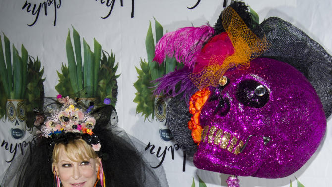 Bette Midler poses alongside a skeleton statue at her Hulaween gala benefit for the New York Restoration Project, in New York, Friday, Oct. 28, 2011. (AP Photo/Charles Sykes)