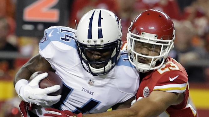 Tennessee Titans wide receiver Hakeem Nicks (14) is tackled by Kansas City Chiefs defensive back Phillip Gaines (23) during the first half of a preseason NFL football game at Arrowhead Stadium in Kansas City, Mo., Friday, Aug. 28, 2015. (AP Photo/Charlie Riedel)