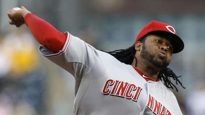 Cincinnati Reds starting pitcher Johnny Cueto throws against the Pittsburgh Pirates in the first inning of the baseball game on Saturday, April 13, 2013, in Pittsburgh. (AP Photo/Keith Srakocic)