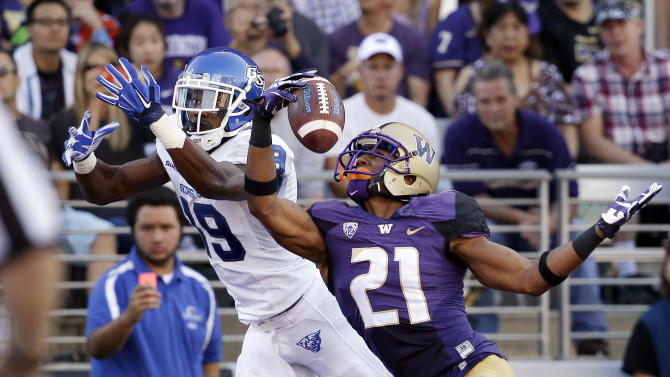 Washington's Marcus Peters (21) snags the ball in the end zone in front of intended receiver Georgia State's Robert Davis in the first half of an NCAA college football game Saturday, Sept. 20, 2014, in Seattle. Peters was flagged for pass interference on the play, leading to a Georgia State touchdown on the drive. (AP Photo/Elaine Thompson)
