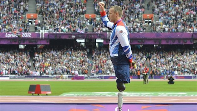 Richard Whitehead of Britain poses at the medal ceremony after winning the Men's 200m T42 classification final at the Olympic Stadium during the London 2012 Paralympic Games (Reuters)
