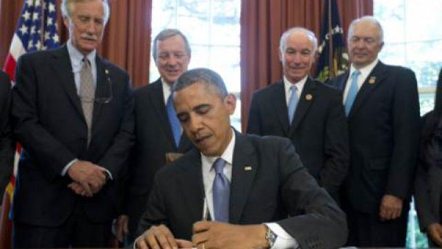 Obama warns GOP he plans to use veto pen in 2015