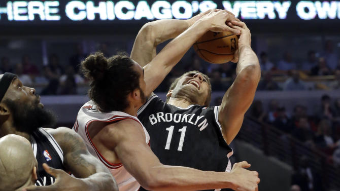 Chicago Bulls center Joakim Noah defends against a shot by Brooklyn Nets center Brook Lopez (11) during the first half in Game 6 of their first-round NBA basketball playoff series in Chicago, Thursday, May 2, 2013. (AP Photo/Nam Y. Huh)