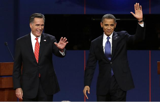 FILE - In this Oct. 3, 2012, file photo, Republican presidential candidate Mitt Romney and President Barack Obama wave to the audience during the first presidential debate at the University of Denver