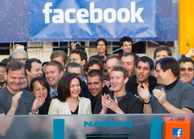 In this image provided by Facebook, Facebook founder, Chairman and CEO Mark Zuckerberg, center, applauds at the opening bell of the Nasdaq stock market, Friday, May 18, 2012, from Facebook headquarters in Menlo Park, Calif. The social media company priced its IPO on Thursday at $38 per share, and beginning Friday regular investors will have a chance to buy shares. (AP Photo/Nasdaq via Facebook, Zef Nikolla)