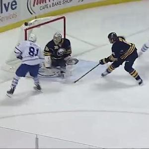 Phil Kessel goes down the boards to score