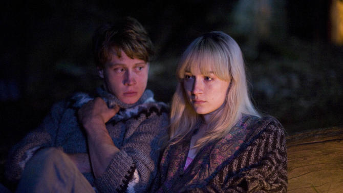 """This image released by Magnolia Pictures shows George MacKay, left, and Saoirse Ronan in a scene from """"How I Live Now."""" (AP Photo/Magnolia Pictures)"""