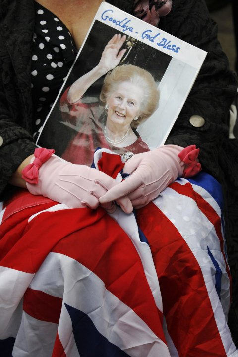 A spectator waits for the funeral procession of former British prime minister, Margaret Thatcher, near St Paul's Cathedral, in London